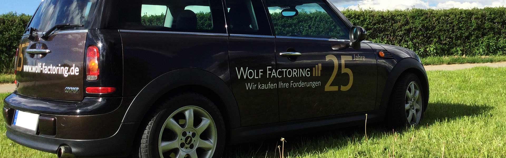 Fahrzeugbeschriftung Stuttgart: Beschriftung für Wolf Factoring, Beifahrerseite
